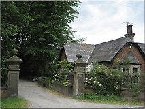 NZ3412 : Lodge and Gateway to Almora Hall by Chris Heaton