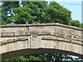 NY6761 : The bridge at Bridge End - detail by Mike Quinn
