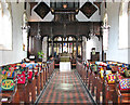 TL8093 : St Leonard's church in Mundford - C19 rood screen by Evelyn Simak