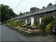 NN9357 : Cottages near the theatre by James Allan