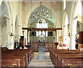 TG3421 : St Michael's church in Barton Turf - view east by Evelyn Simak
