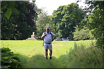 SK0972 : Hiker at King Sterndale by Adrian Channing