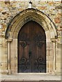 NY7064 : The Church of the Holy Cross, Haltwhistle - south door by Mike Quinn