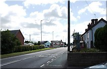SJ2618 : A483 in Four Crosses, looking towards the junction with the B4393 by David Gearing