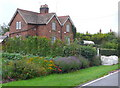 SP3274 : Cottages at Kings Hill by Nigel Mykura