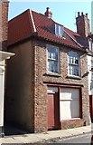 TA1767 : Boarded up shop, High Street, Bridlington by Stefan De Wit