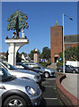 SP0184 : 'Court Oak' pub sign & car park with church over the road by Row17