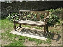 TM2850 : Melton, St Andrew: millennium seat by Basher Eyre