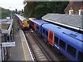 TQ2275 : Trains at Barnes Station by John Lord