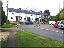 SP7711 : A terrace at the bend in Upton by Roger Templeman