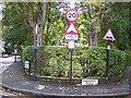 SJ3985 : Proliferation of signage at Cressington by Raymond Knapman