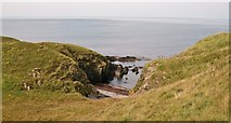 SH2035 : Small cove north-east of the Afon Gyfynus valley by Eric Jones