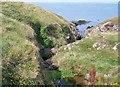 SH2035 : Afon Gyfunus at the cliff top north of Penrhyn Melyn by Eric Jones