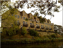 SE1039 : Buildings above the Leeds Liverpool Canal in Bingley by Andrew Abbott