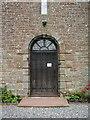 NY3745 : All Saints Church, Raughton Head, Doorway by Alexander P Kapp