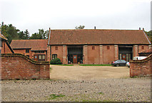 TG2202 : Barn conversions at Common Farm, Dunston by Evelyn Simak