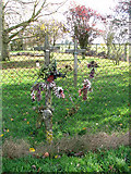 TM1888 : Commemorative crosses on the fence by Evelyn Simak