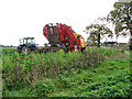TM2091 : Tractor and sugar beet harvester in field beside Parker's Lane by Evelyn Simak