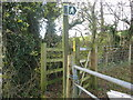 ST6057 : Footpath sign and stile by Dr Duncan Pepper