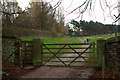 SJ9682 : Gate and Bench Marked Gatepost by Mark Anderson