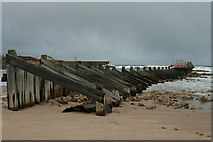 NJ2370 : Lossiemouth's breakwater on the East Beach by Des Colhoun