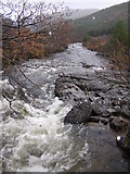 NM8464 : Strontian River from upper footbridge by Peter Bond