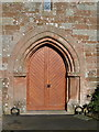 NY3767 : The Parish Church of St Michael & All Angels, Arthuret, Doorway by Alexander P Kapp
