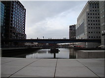 TQ3780 : DLR bridge over Heron Quays by Robert Lamb