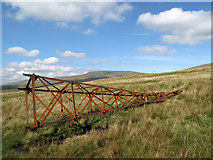 NY6931 : Toppled pylon on west side of Great Dun Fell by Trevor Littlewood