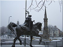SP4540 : The fine lady on a white horse and Banbury Cross in the snow by Richard Humphrey