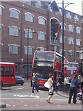 TQ2775 : Buses on Lavender Hill by David Howard
