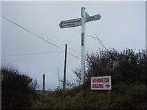 SX5646 : Stoke Cross signpost by David Smith