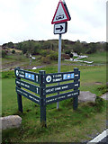 SH7783 : Roadside signs near St Tudno's Road, Great Orme by Phil Champion