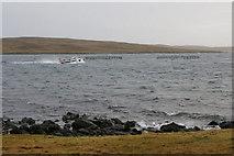HU5899 : Boat passing Knowe of the Wick, near Heogland by Mike Pennington