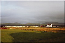 SH4356 : Looking towards Snowdonia from Dinas Dinlle by nick macneill
