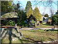 ST3794 : Village well, with church lych gate, Tredunnock by Ruth Sharville