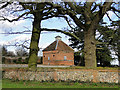 TG0436 : Dovecot at Thornage Hall by Adrian S Pye