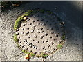 SP3375 : Manhole cover outside the Old Mill, Baginton by John Brightley