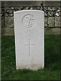 TQ2565 : Commonwealth War Grave, Benhilton churchyard by Stephen Craven