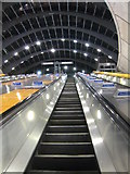 TQ3780 : Ascending the escalator at Canary Wharf station by Rod Allday