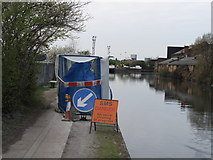 TQ2282 : Cleaning power cable under canal towpath by David Hawgood