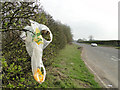 TG2030 : Discarded plastic bag and orange peel on the A140 by Adrian S Pye