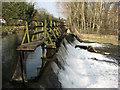 SK3538 : Weir and footbridge at Darley Abbey by John Sutton