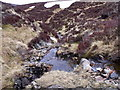 NN6770 : Allt Poll Tairbh Shuas finding the gravity to cut its course through the rocks above Dalnaspidal by ian shiell