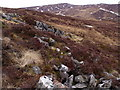 NN6670 : Rock outcrop on slopes south of Allt Choire Leathanaidh near Dalnaspidal by ian shiell