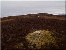 NN6667 : Grit for the grouse between Allt Leathad Easain and Carn Dearg near Loch Errochty by ian shiell