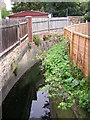 TQ3268 : Boswell Road: looking upstream at the crossing of Norbury Brook by Christopher Hilton