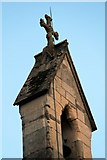 SH5638 : Cross and Lightning Conductor, St John's, Porthmadog by Christine Matthews