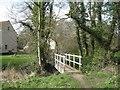 TG1833 : Footbridge over Scarrow Beck by Robin Stott
