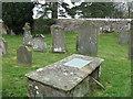 NY4536 : Graveyard tribute to a 'venerable couple' by M J Richardson